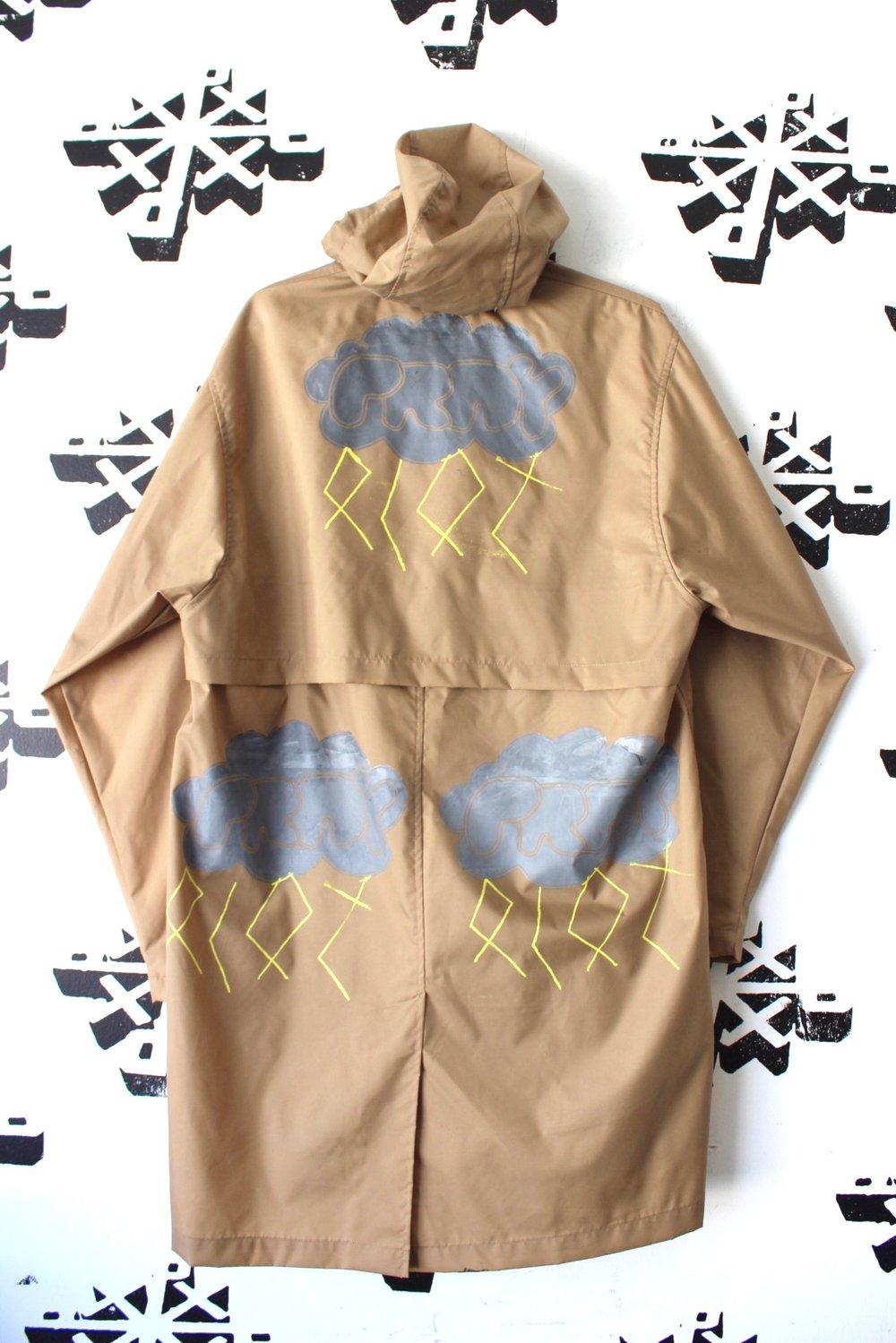 when it rains rain jacket in tan