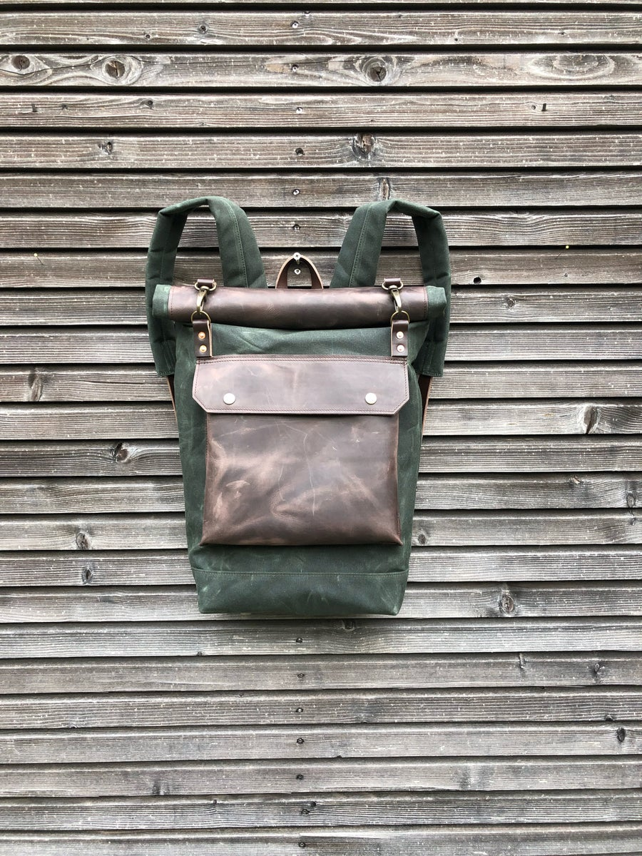 Image of Backpack in waxed canvas with waxed leather front pocket and roll to close top