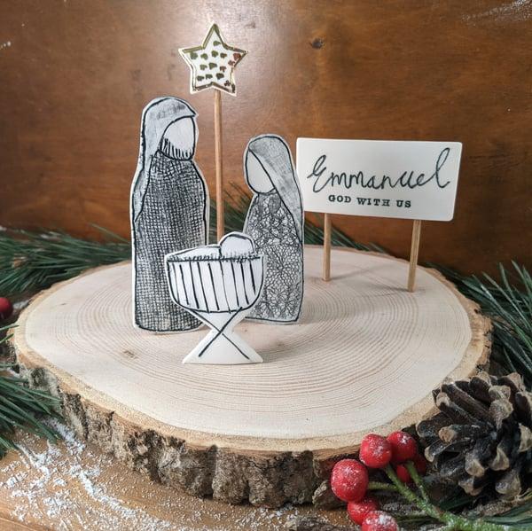 Image of Nativity Scene on Wooden Slice