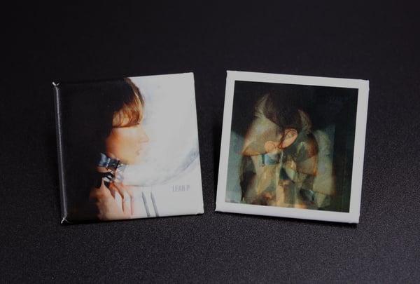 """Image of Leah P """"Surviving the Familiar"""" button set."""