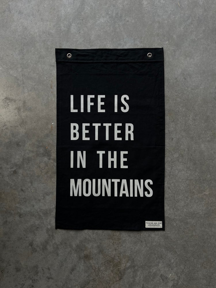 Image of LIFE IS BETTER IN THE MOUNTAINS FLAG - BLACK