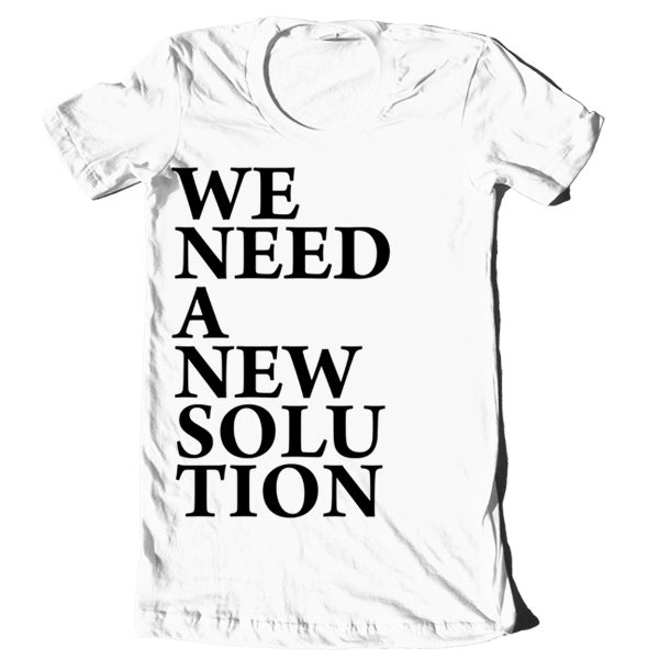 "Image of ""We Need A New Solution"" Block Letters Shirt"