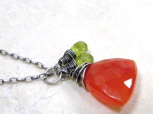 Image of perfect carnelian with peridot accents