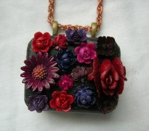 Image of SOLD - Noir Flowers Miniature Clockwork Music Box Pendant