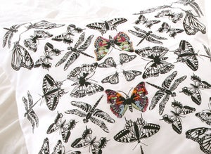 Image of Black and white insect cushion WITH INTRICATE EMBROIDERY AND BEADWORK