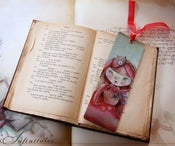 Image of Little Brown Sleeping Wolf - Deluxe laminated bookmark