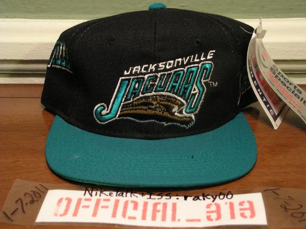 9314ee333 VINTAGE JACKSONVILLE JAGUARS ALL OVER TEXT SPORTS SPECIALTIES SNAPBACK CAP  HAT