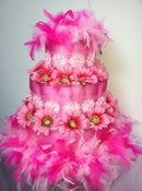 Image of Pink feathers and fun Baby Diaper Cake