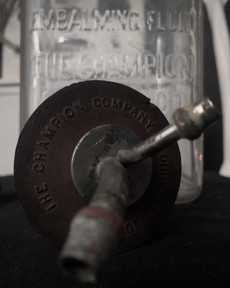 Image of Champion Embalming Bottle
