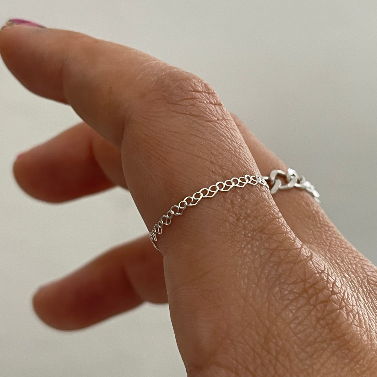 Image of plain heart chain ring