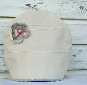 Image of Cream corsage tea cosy
