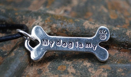 "Image of ""WonderDog"" Pewter Pendant on expresso cord"