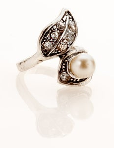 Image of Faux pearl and white stone encrusted ring.