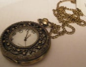 Image of Clock pendant style 1.