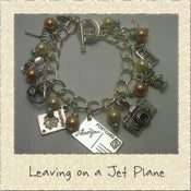 Image of 'Leaving on a Jet Plane' Holiday Themed Charm Bracelet