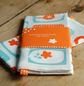 Image of Screen printed orange/blue Tea Towel