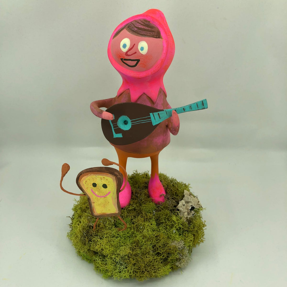 Image of A bard and a dancing piece of toast. One of a kind sculpture.