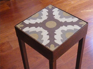 Image of Brown, grey and soft ochre plant stand