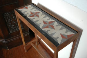 Image of Terracotta, grey, beige and black console
