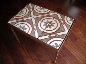 Image of Red lines on creme and grey coffee table