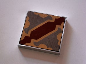 Image of Ochre, ox blood and grey hydraulic tile coaster