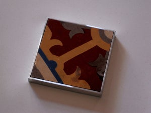 Image of Ochre, ox blood, grey and blue hydraulic tile coaster