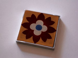 Image of Yellow flower cement tile coaster