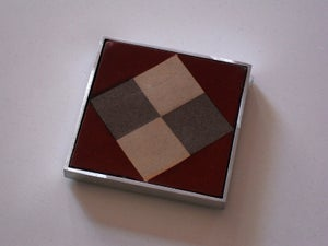 Image of Four square rust and grey cement tile coaster