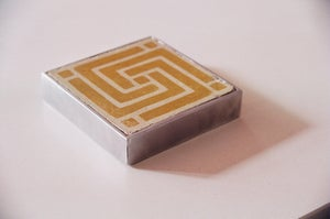 Image of Ochre labyrinth cement tile coaster