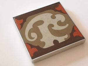 Image of Orange, cream and brown trivet