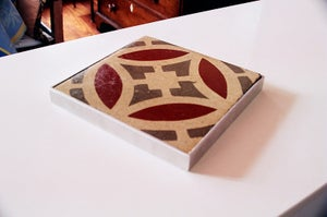 Image of Round creme, grey and oxblood trivet