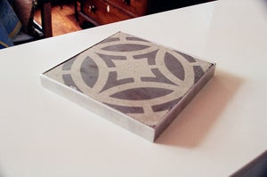 Image of Round off white and grey trivet