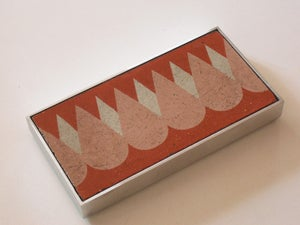 Image of Pink, red and cream drops cement tile trivet