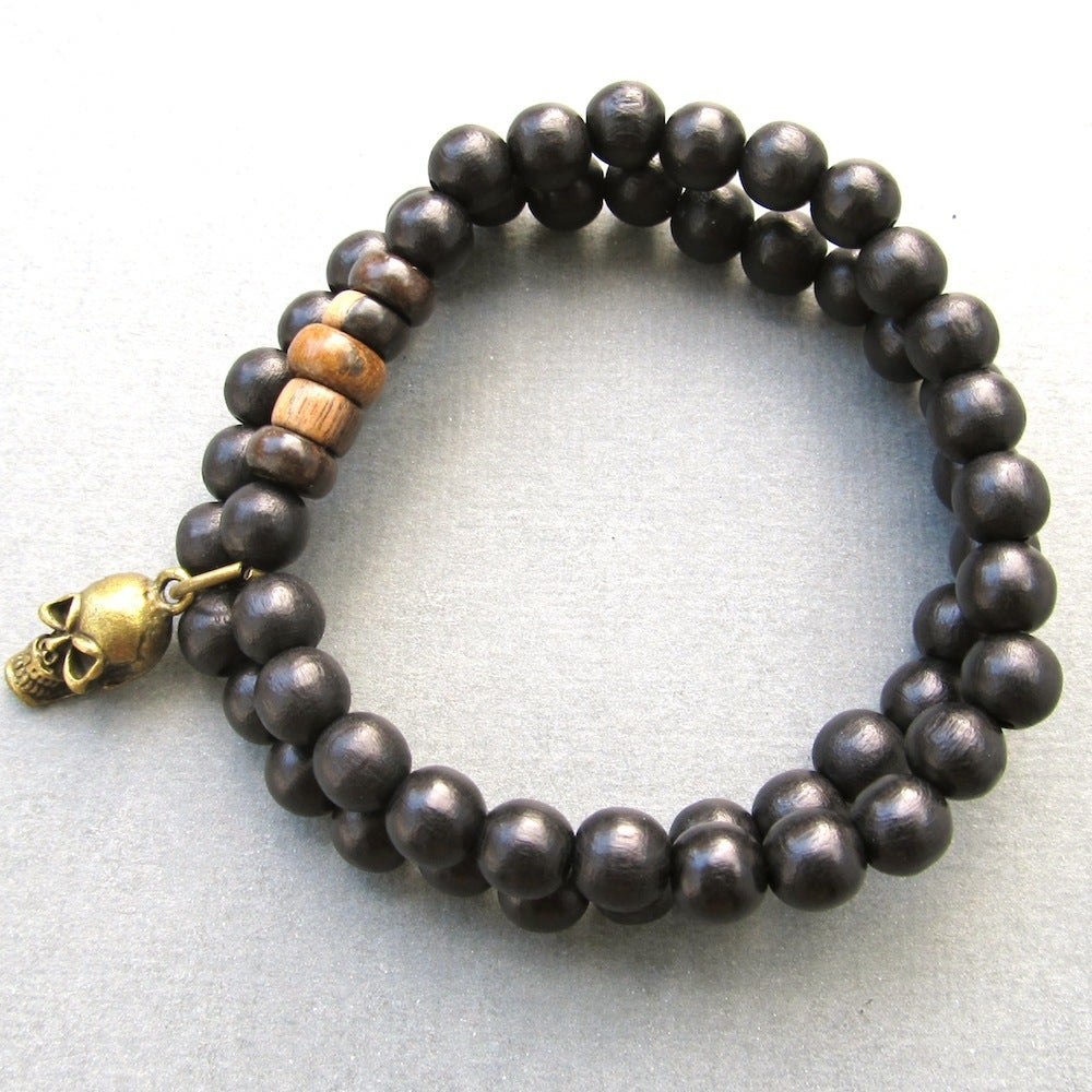 Image of Double black beaded stretch bracelets with skull charm