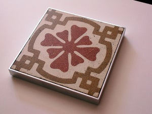 Image of Red flower with brown swirl trivet