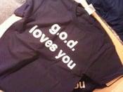 Image of chris gerolmo and g.o.d. teeshirt
