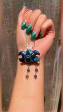 Image 1 of aura coated obsidian triple goddess necklace