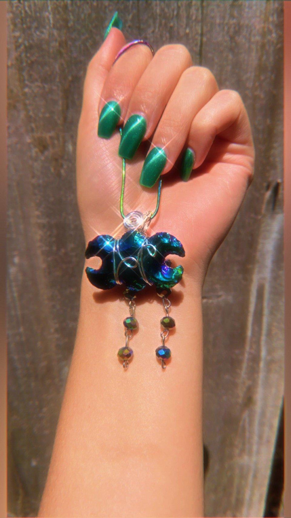 Image of aura coated obsidian triple goddess necklace