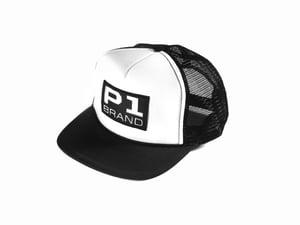 "Image of ""Badged"" Trucker Hat, Black/White (P1B-T0501)"