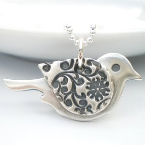 Image of Orange Blossom Silver Bird Pendant