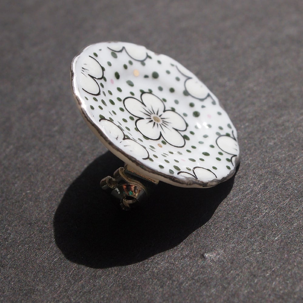 Image of silver spotty pin