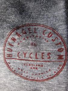 Image of Hufnagel Badge T-shirt (close up)
