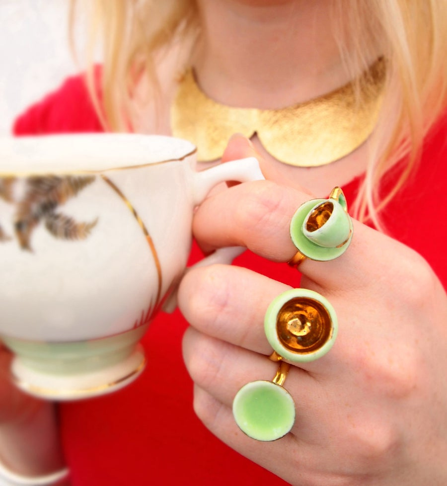 Image of cup and saucer ring