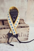 Image of yellow fields camera strap