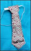 Image of reversible mustache/monkey tie