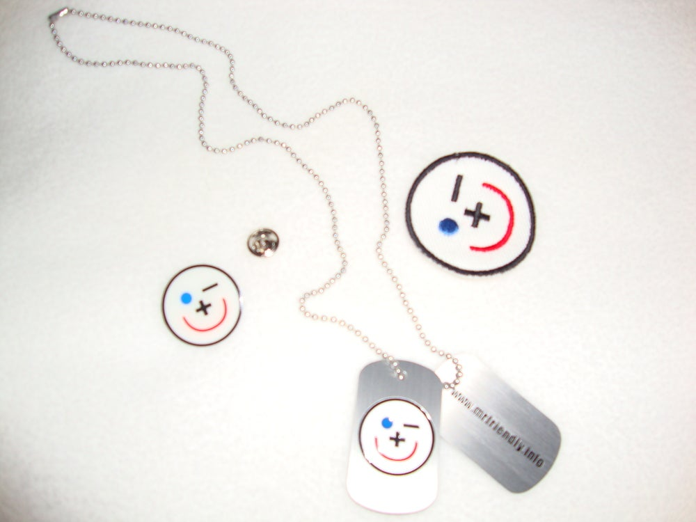 "Image of 1 Dog Tag, 1 Lapel Pin, 2"" Patch, Window Cling or 15 Buttons"