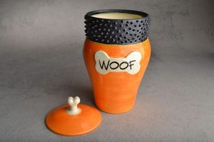"Image of Dog Treat Jar Orange Spiky Collared ""Woof"""