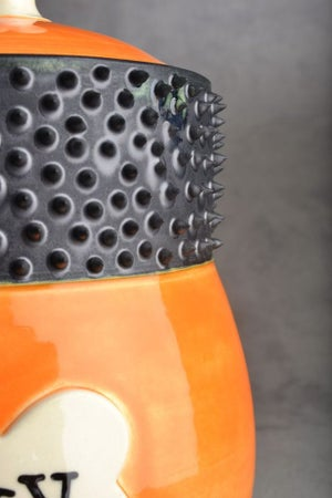 "Image of Dog Treat Jar Orange Spiky Collared ""Hexy"""