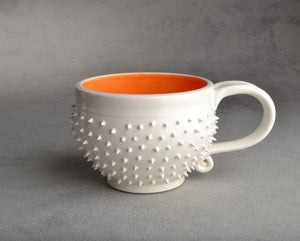 Image of Spiky Mug White and Orange Soup Cocoa Mug Made To Order By Symmetrical Pottery