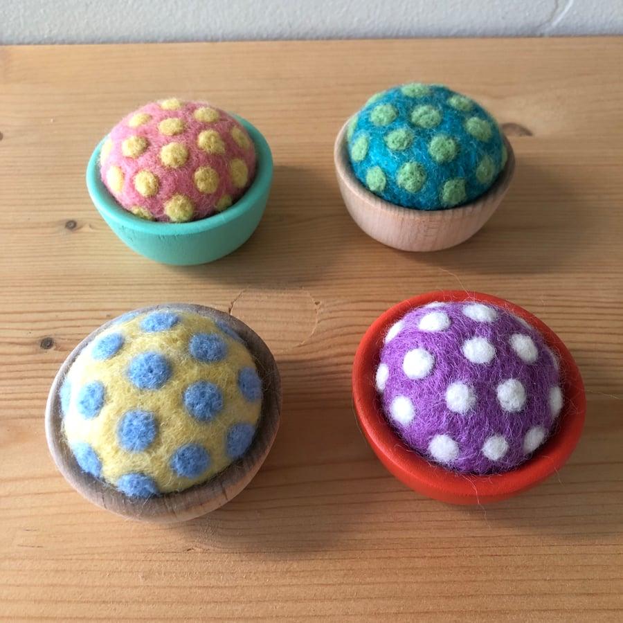 Image of wool polka dot pincushions